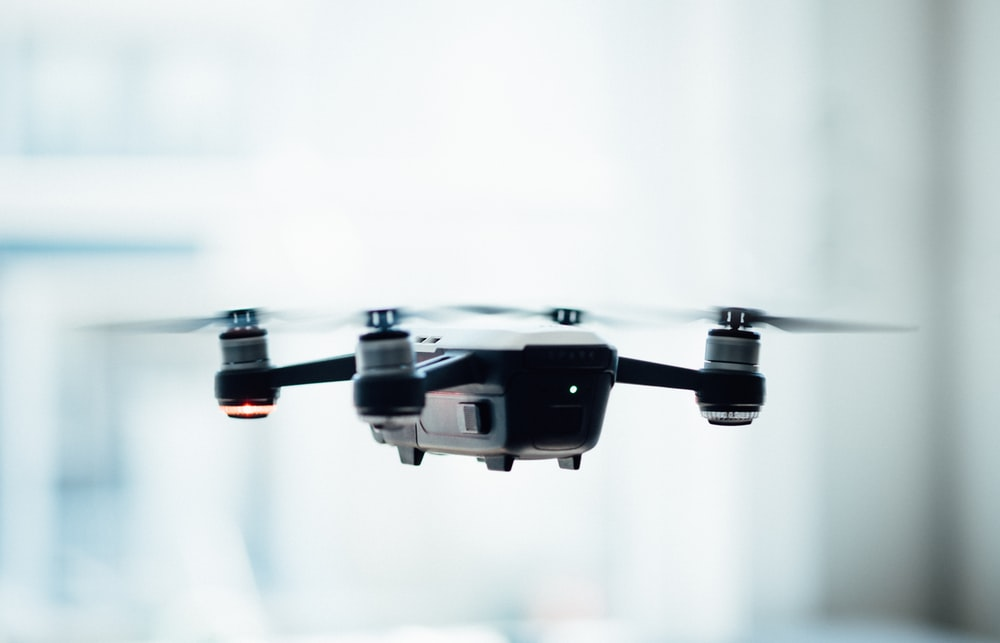 black quadcopter drone selective focus photograph