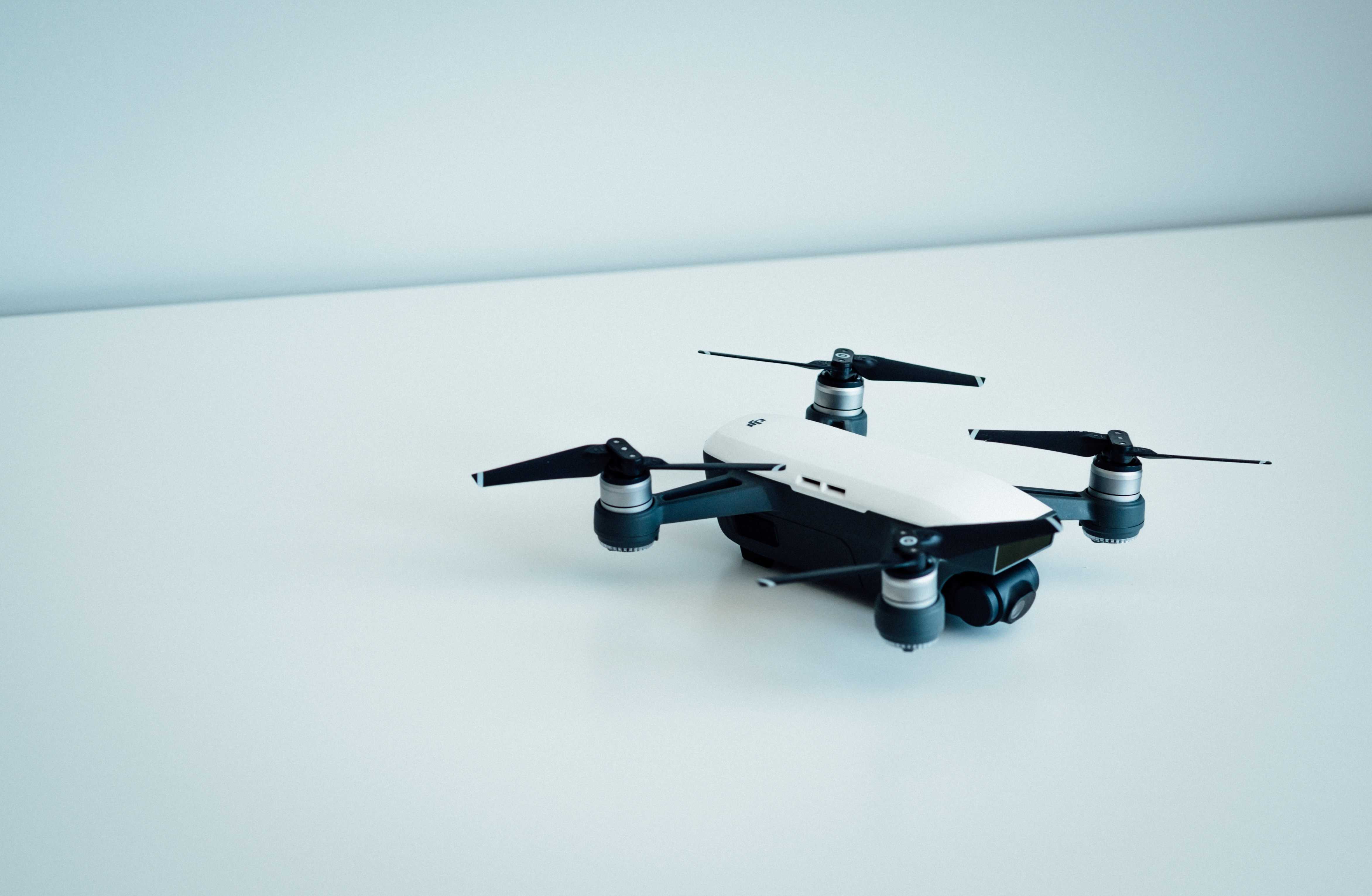 white and black quad copter drone