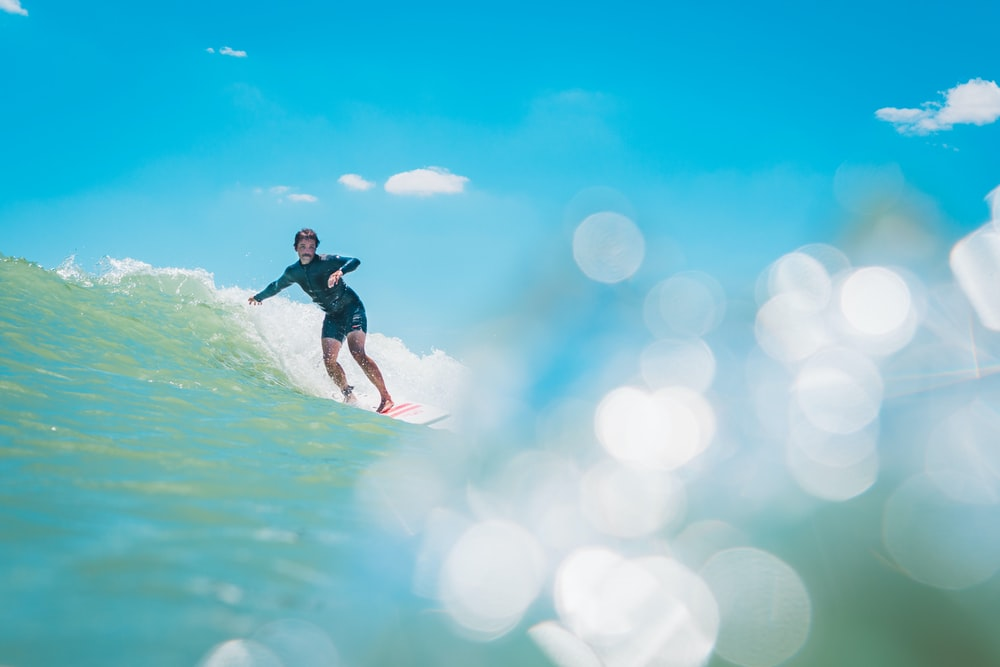 person surfing on wave during daytime