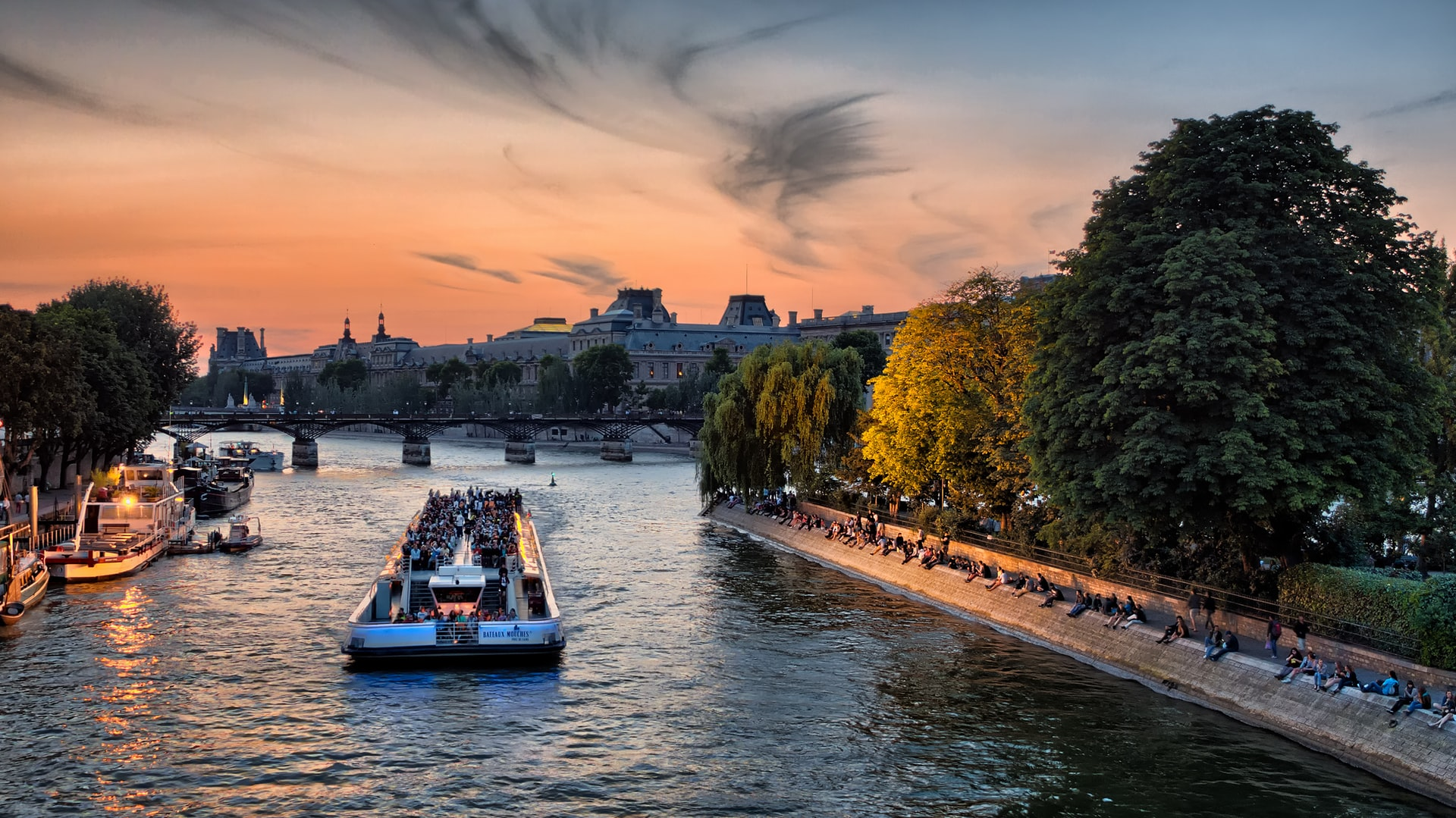 River cruise along the Seine in Paris at sunset