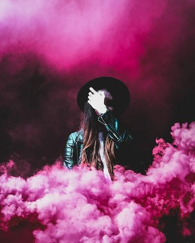 person standing around pink smokes