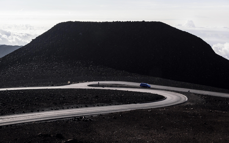 blue car driving on asphalt road