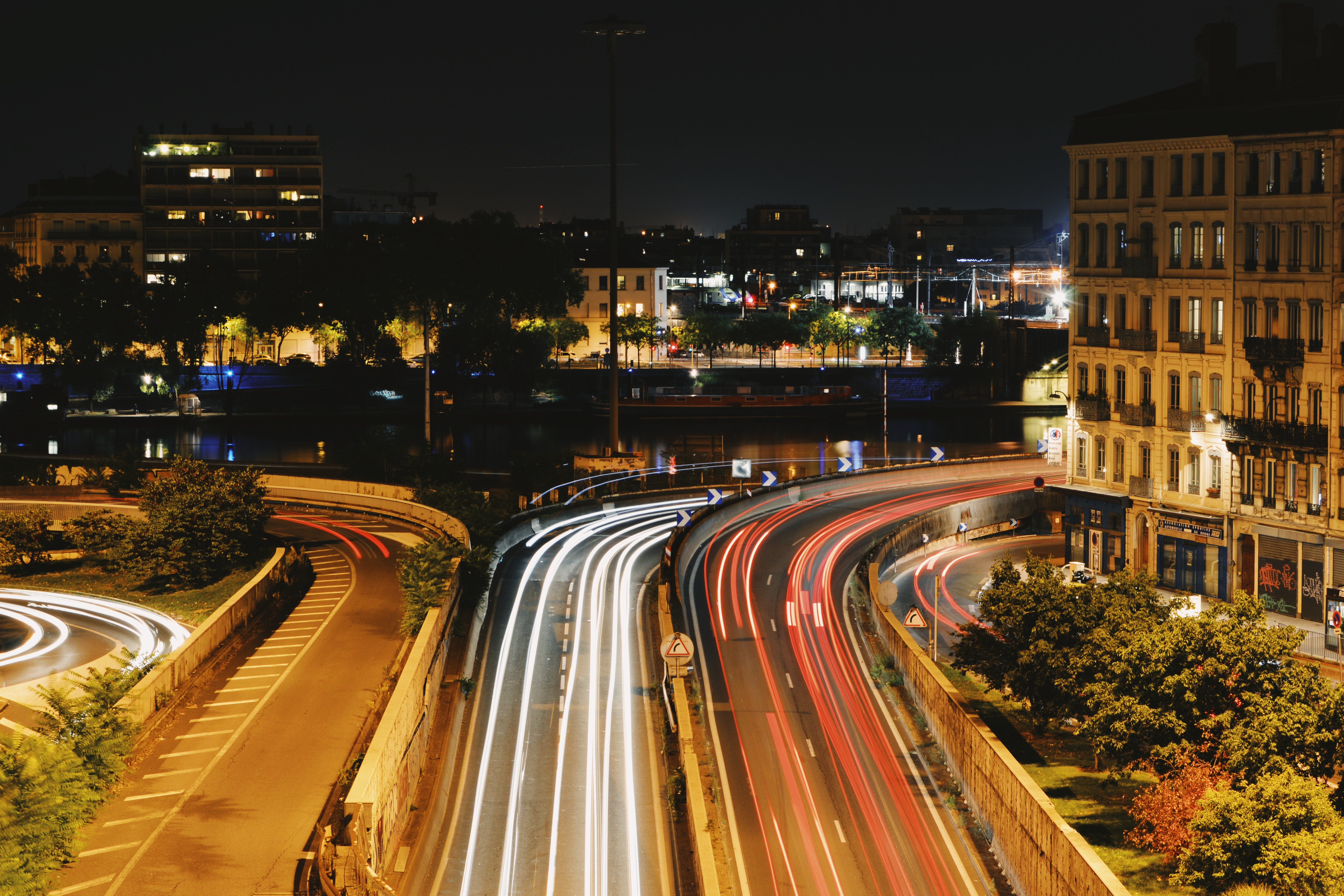 timelapse photo of cars on road during nighttime