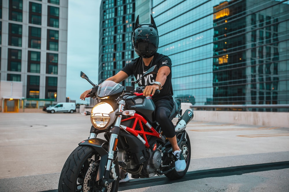 man riding naked motorcycle with helmet on