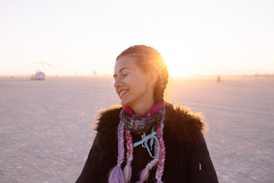 woman in the desert burning man teams background