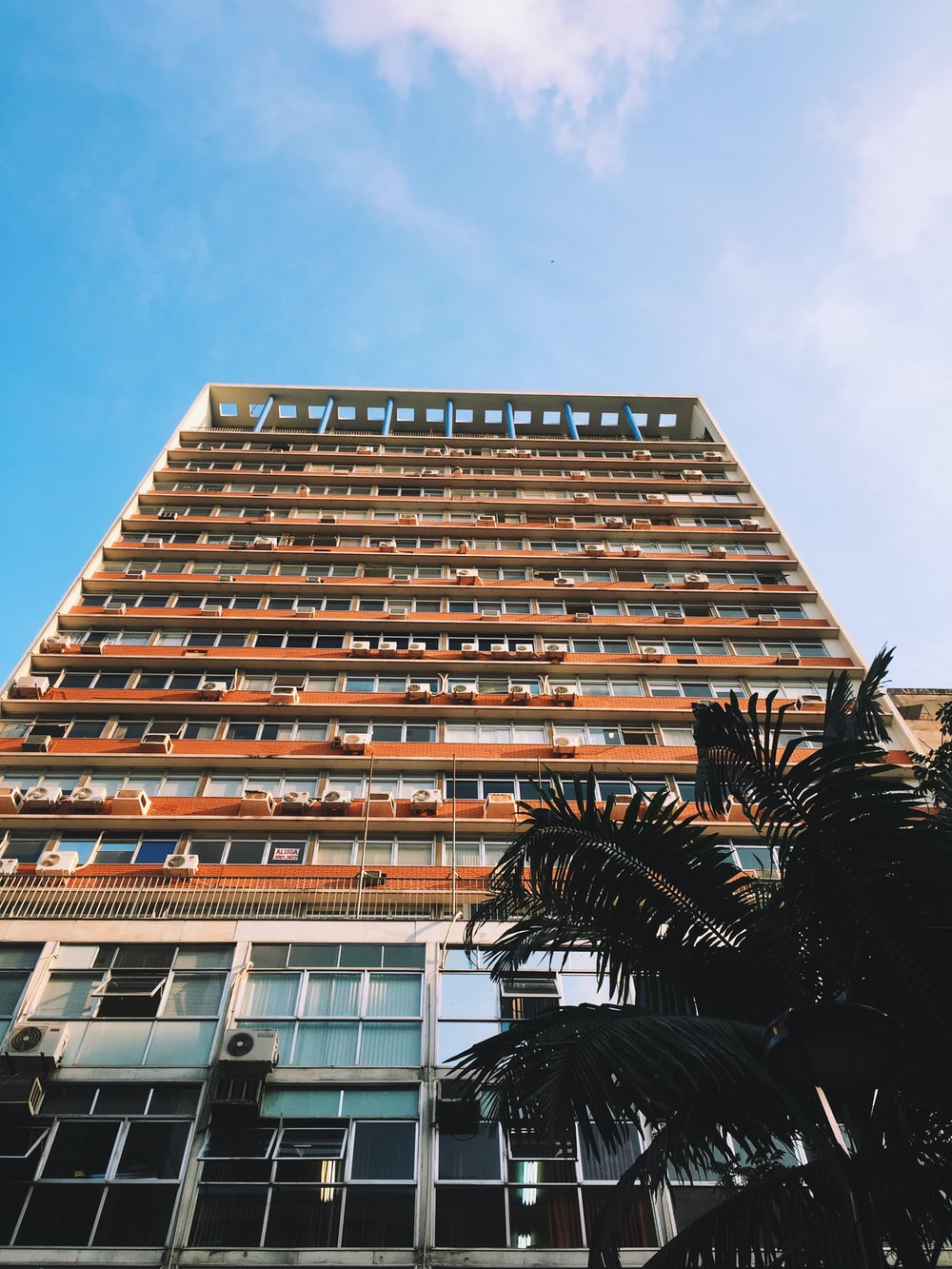 orange and white painted high-rise building