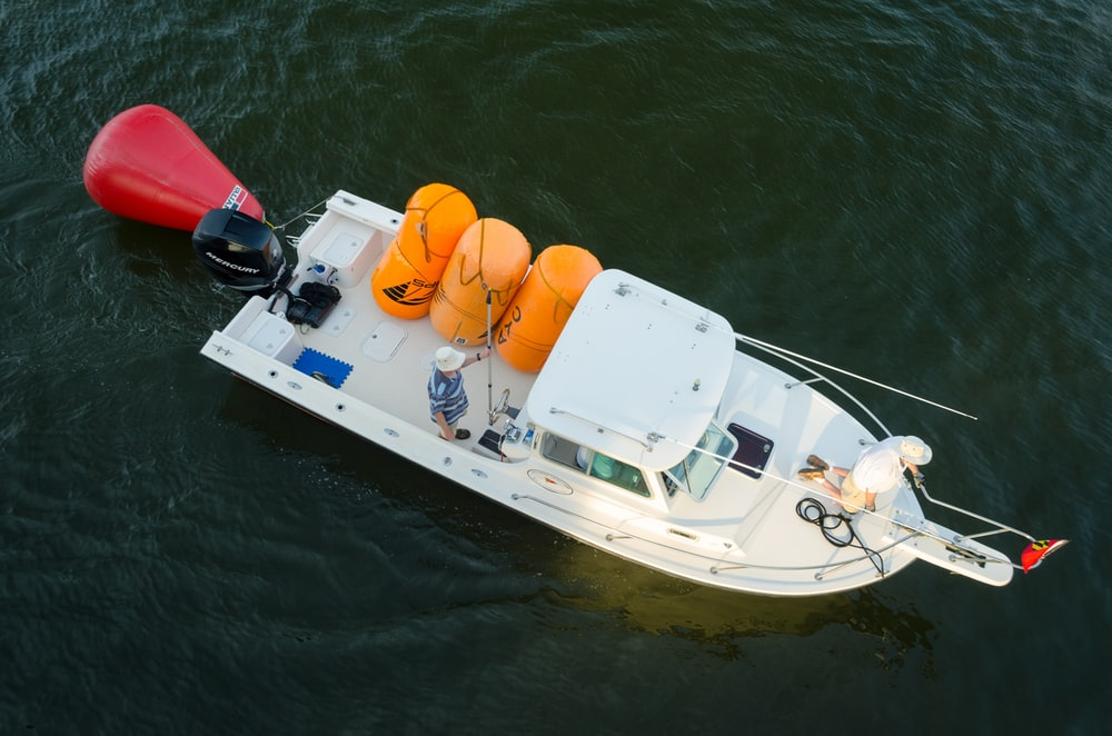 top view photo of white yacht on body of water
