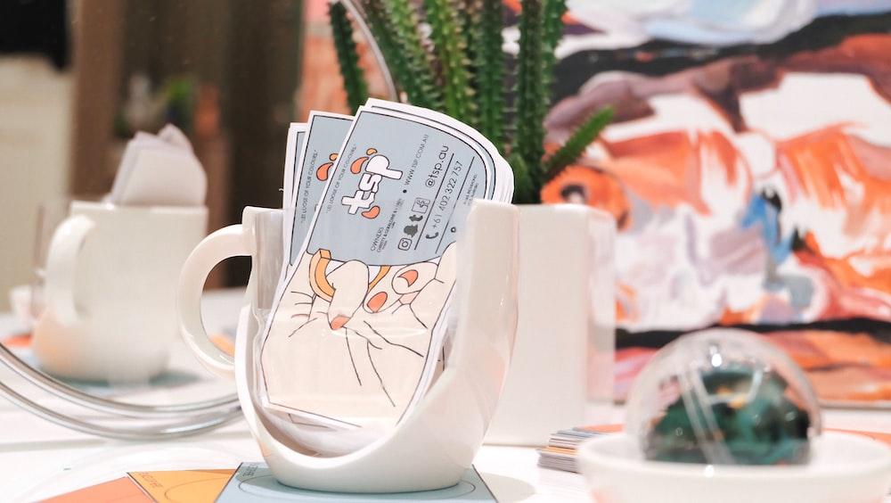 white ceramic mug holder