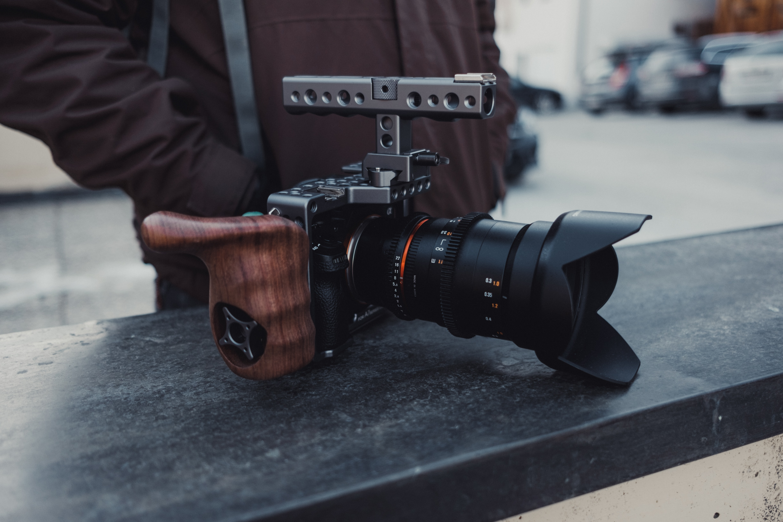 black DSLR camera on top of black table