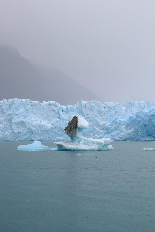 iceberg on body of water at daytime