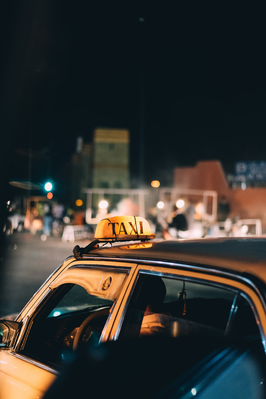black taxi car during night