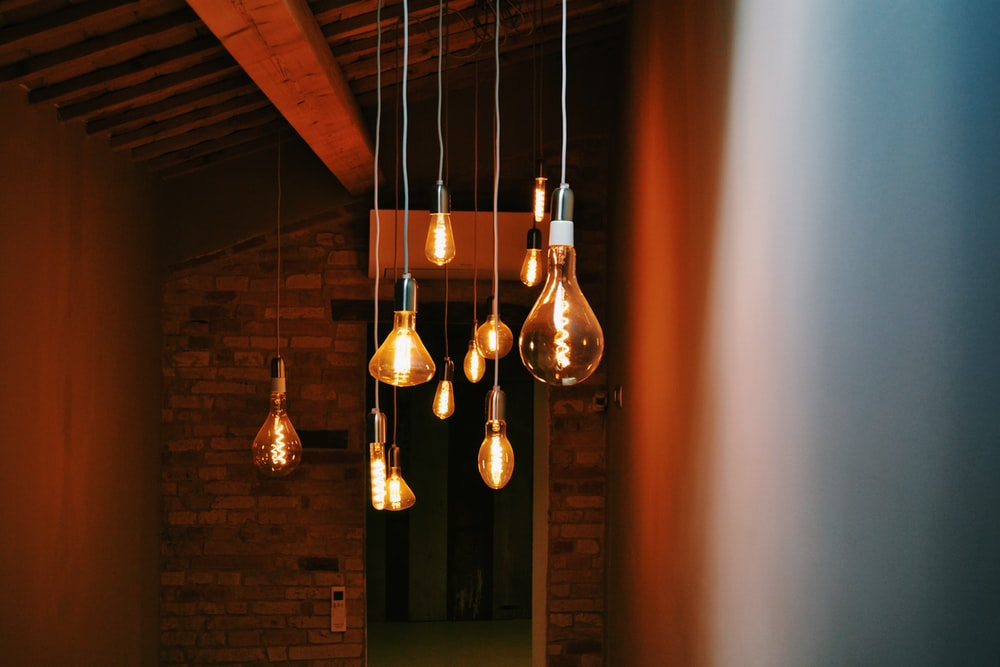 turned on orange pendant lamps