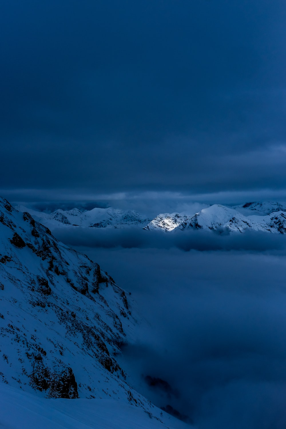 snow capped mountain covered in clouds