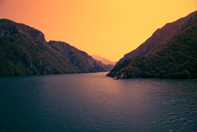 river surrounded by mountain photo during dawn albania zoom background
