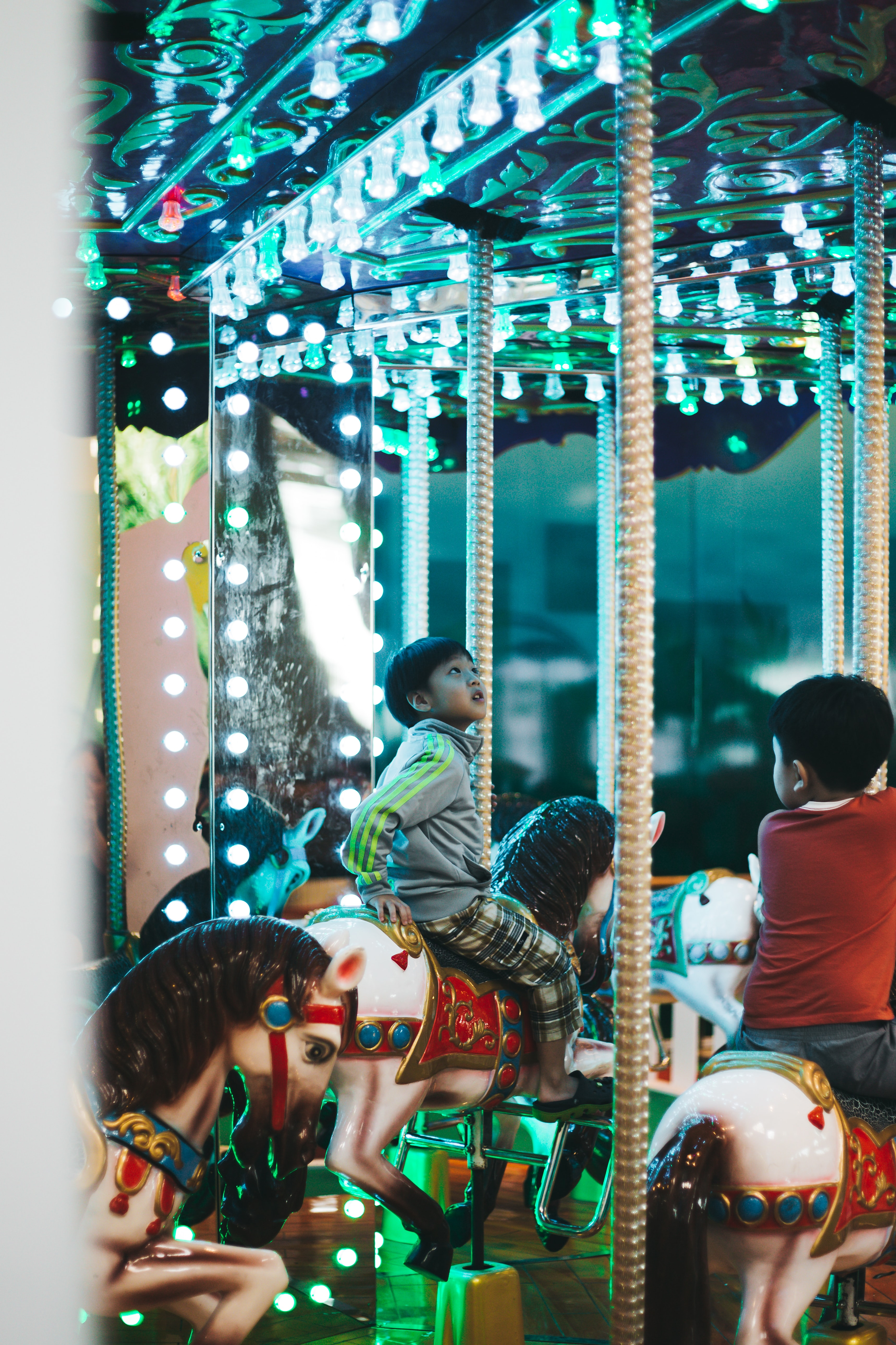 boy riding on carousel