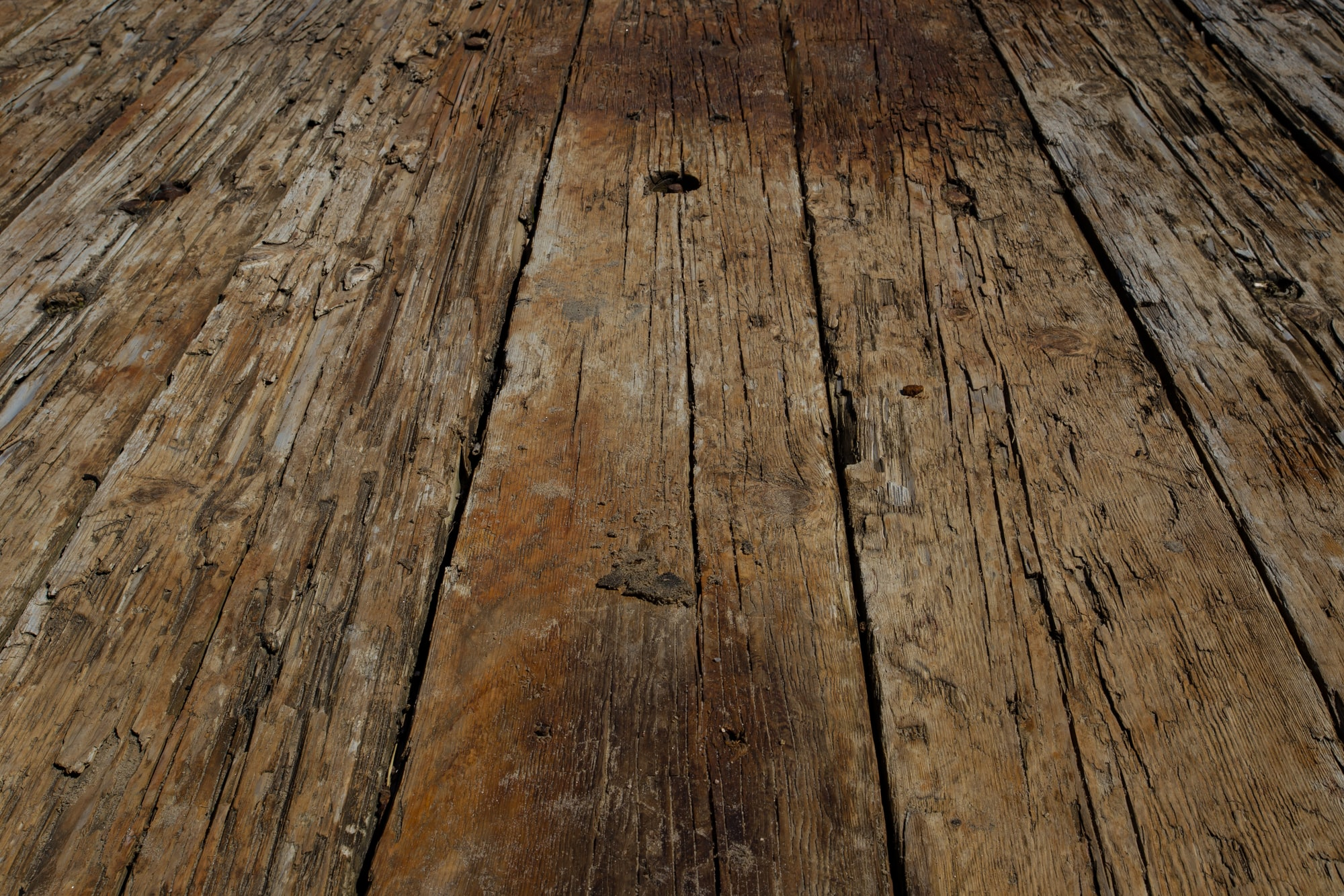 - Part of a 30 days streak of Unsplash uploads - Wandering on the shore of the St Lawrence river when I stumbled upon a shipwreck. Among the last things that were remaining were this floor of wood. The texture, shapes, and lines appealed to me. There's something beautiful in seeing this that once was a magnificent ship. Like a fossil, but of a human built device.