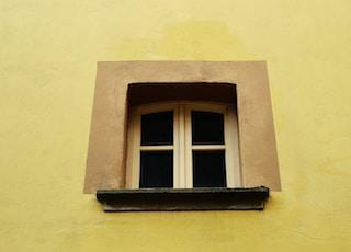 closed white wooden framed 2-pane window