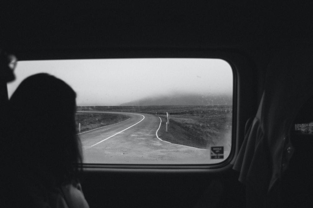 woman looking outside automotive window