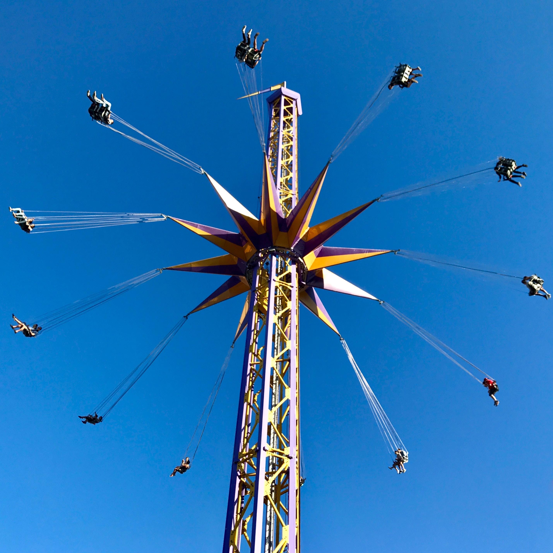 person amusement park rides taken at daytime
