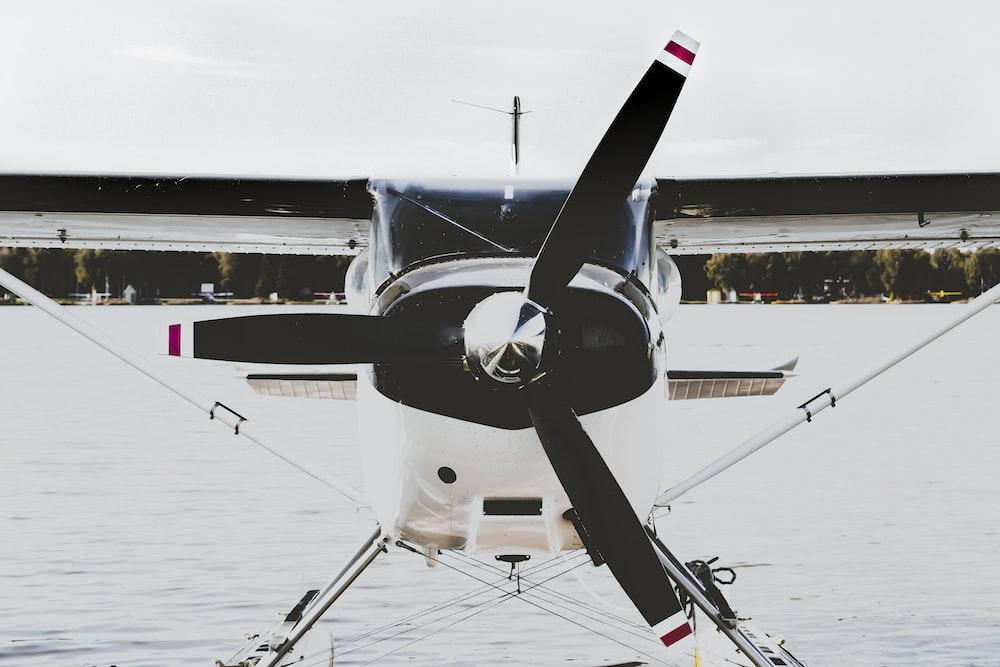 white and black propeller plane