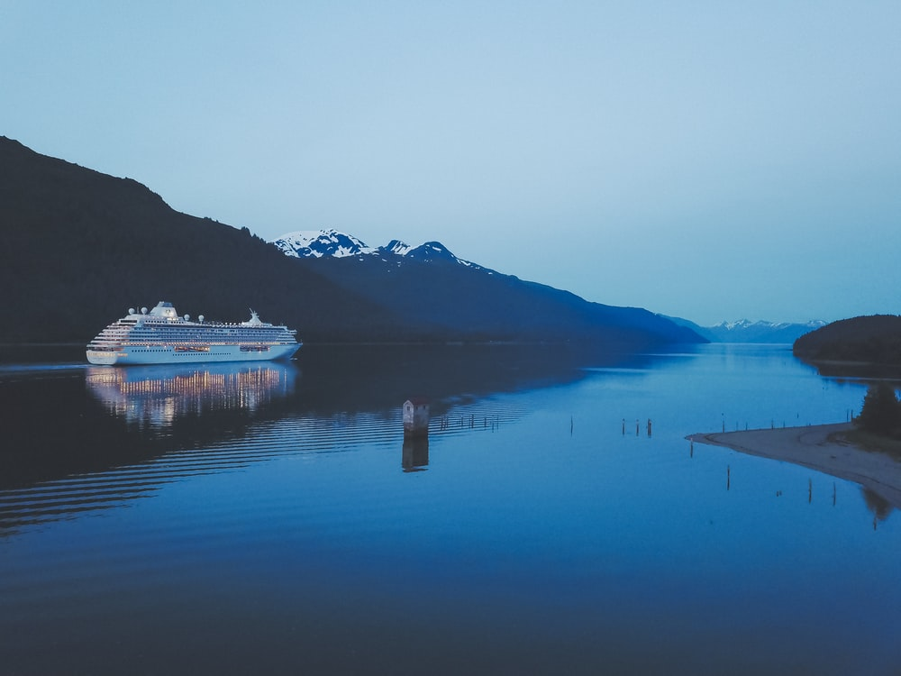 white cruise ship on body of water