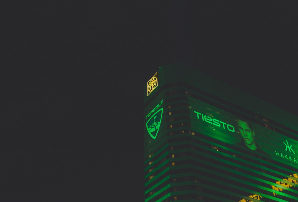 Tiesto digital billboard on high-rise building during night