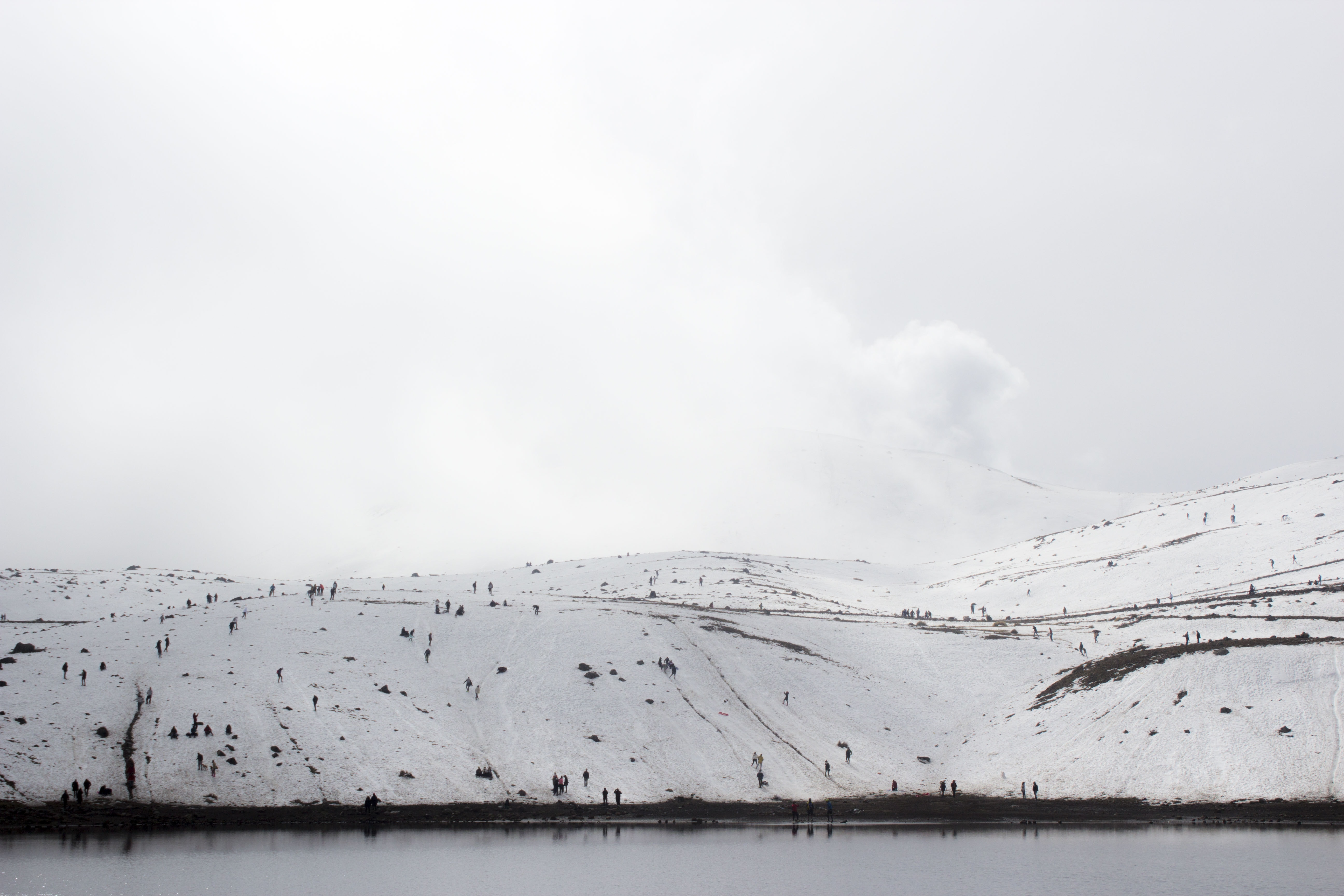 snow-covered land near body of water