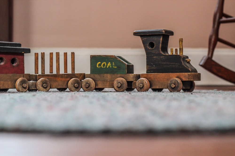 beige wooden toy train selective focal photo
