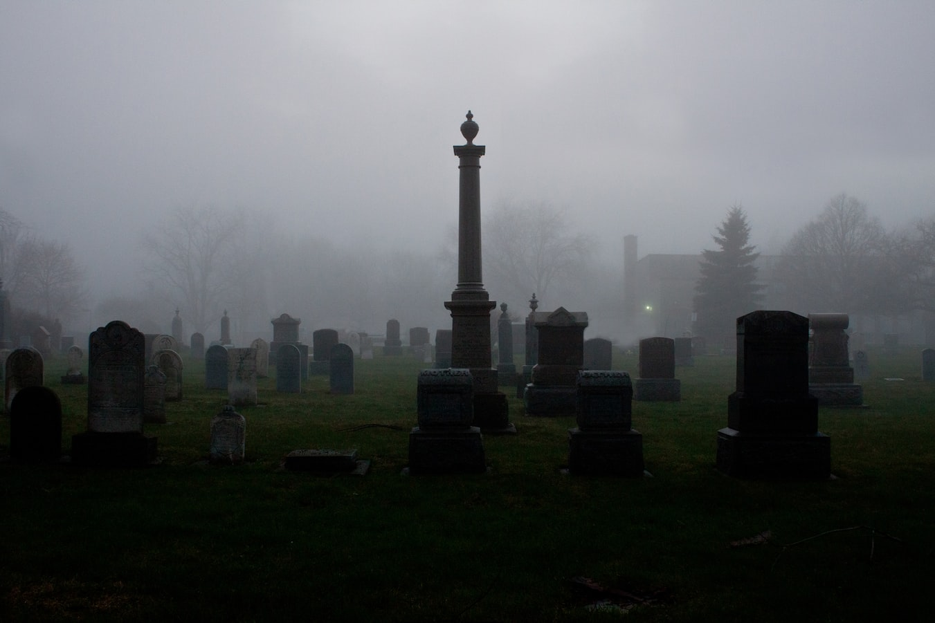 black and white foggy cemetery