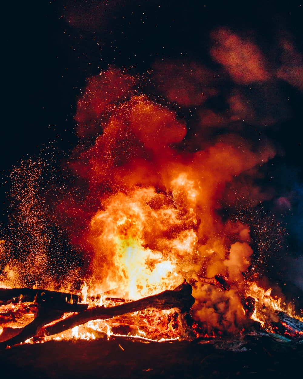 fire with black smoke during night