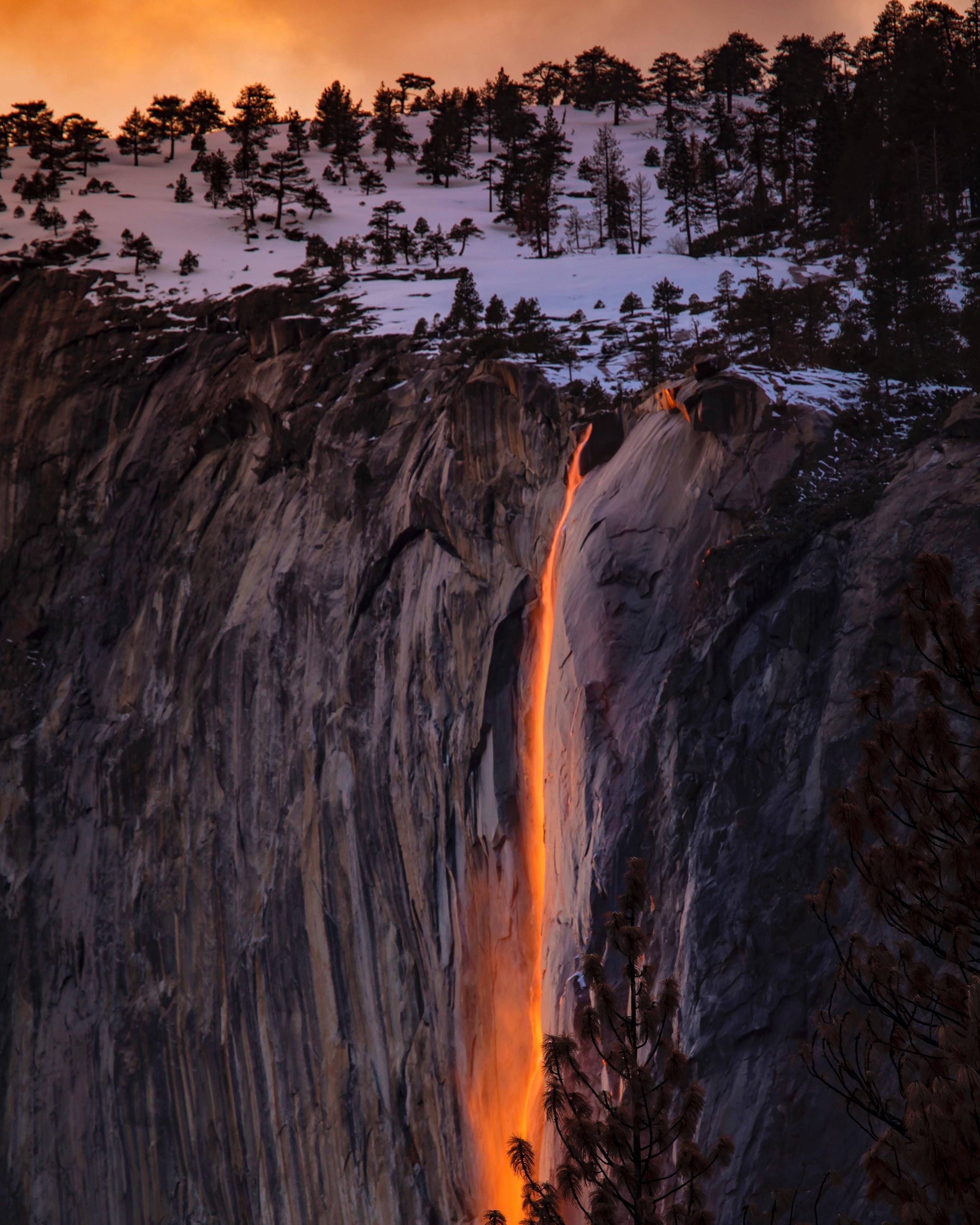 waterfalls near cliff at golden hour