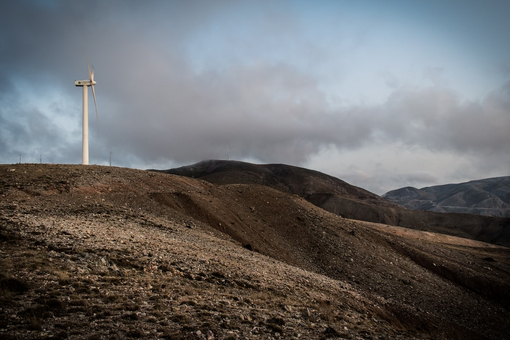 low-angle photography wind turbine under white sky