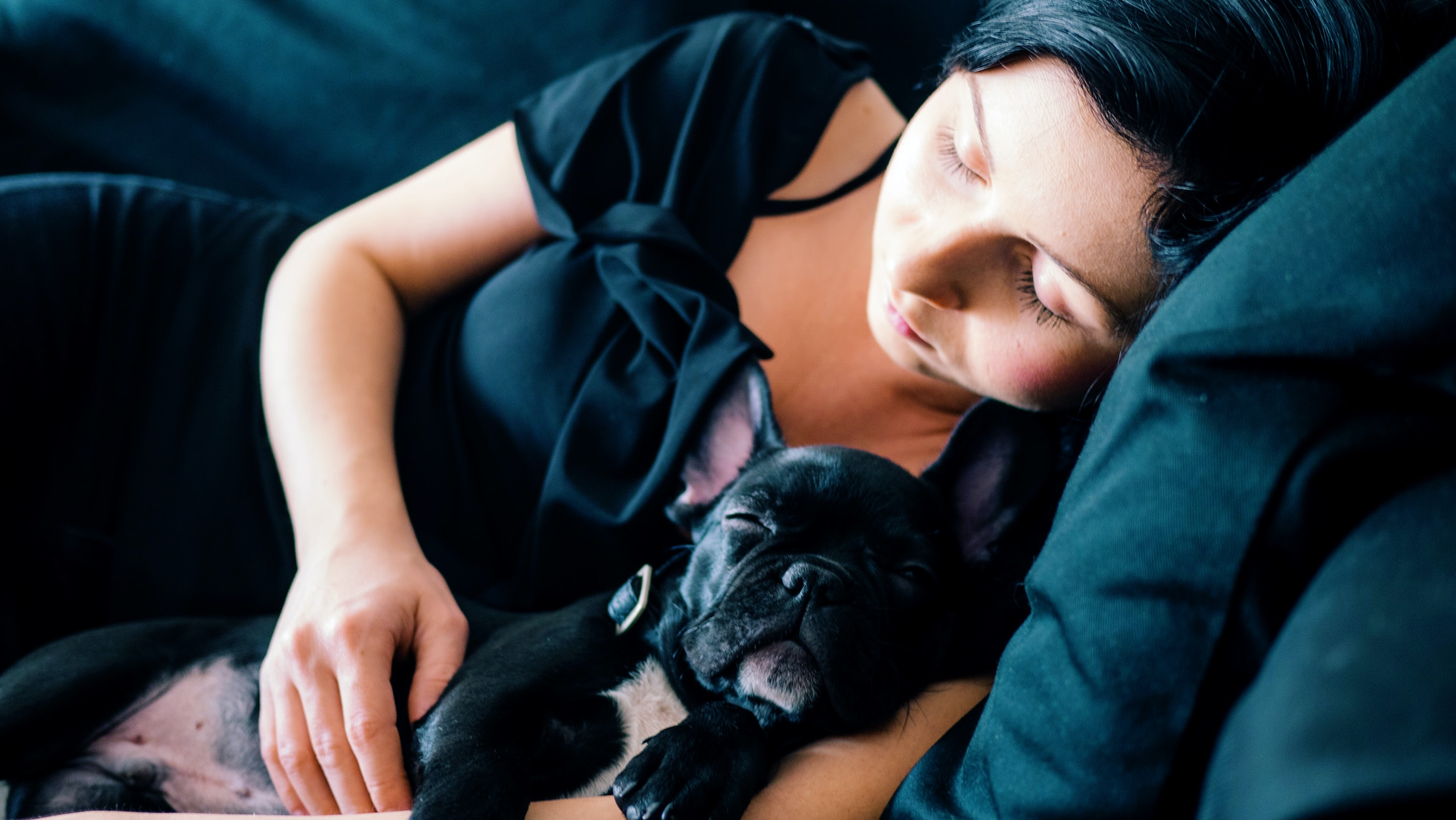 A woman and her dog taking a nap