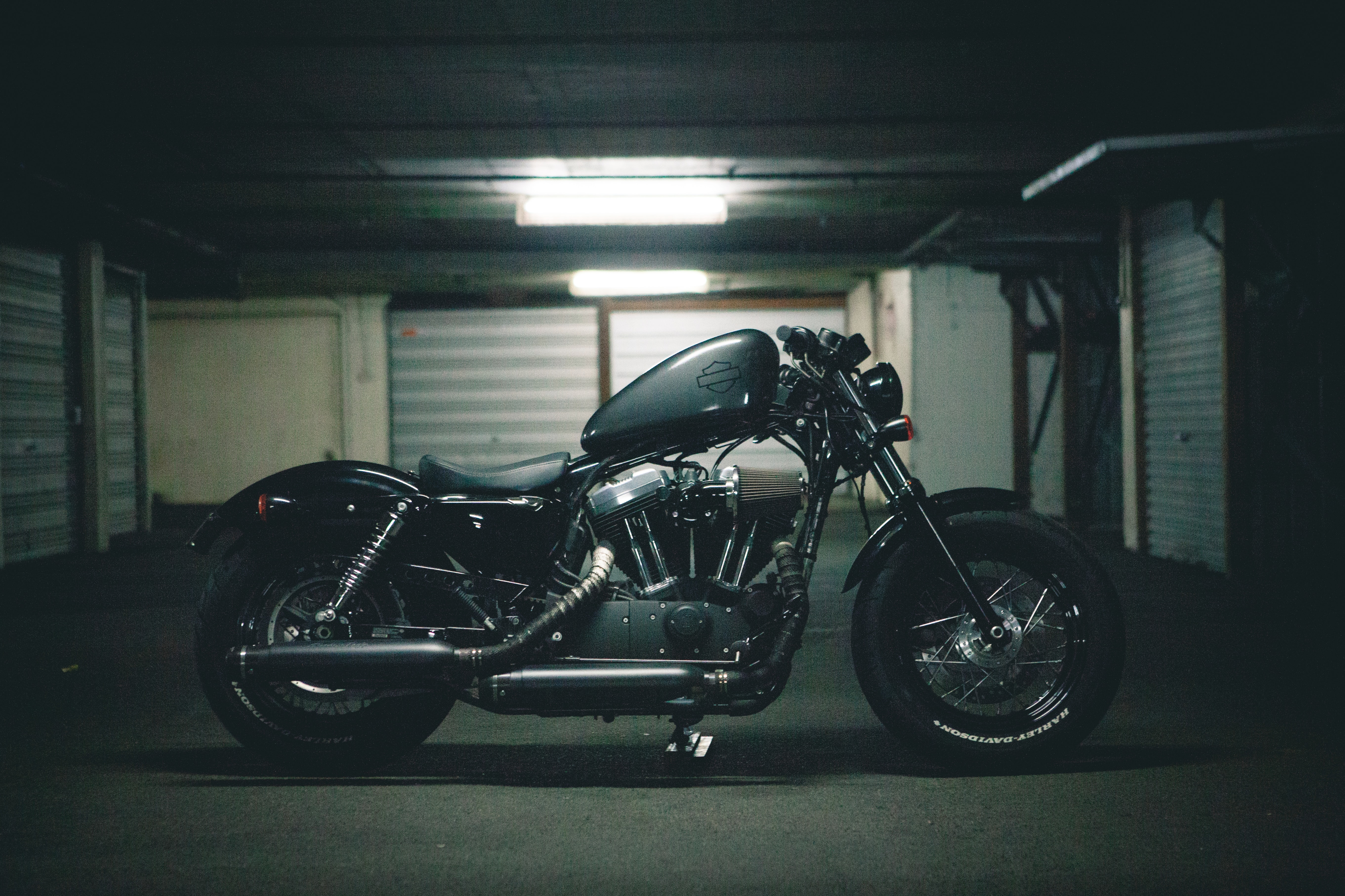 black bobber motorcycle inside garage