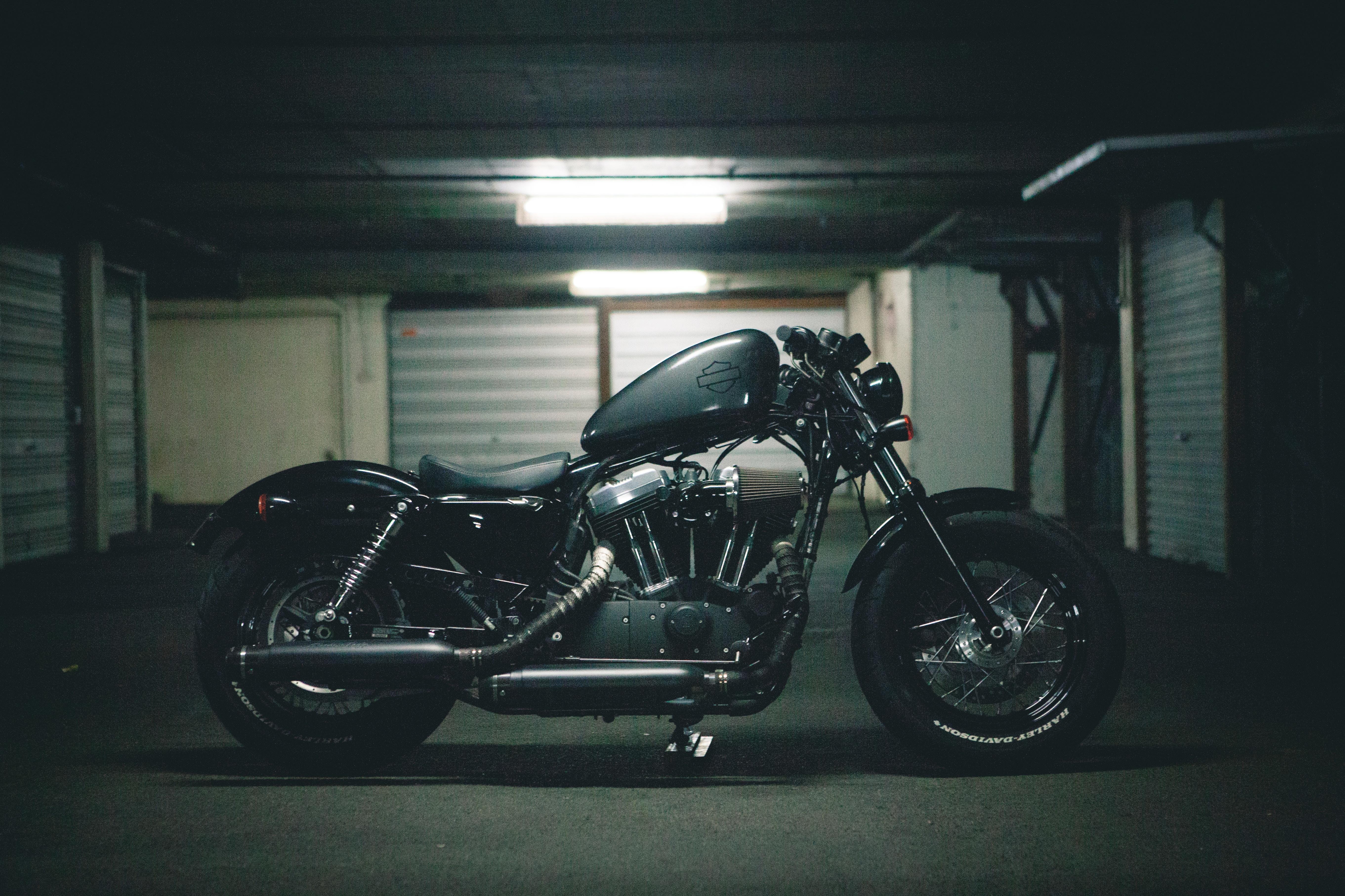 black bobber motorcycle inside garage