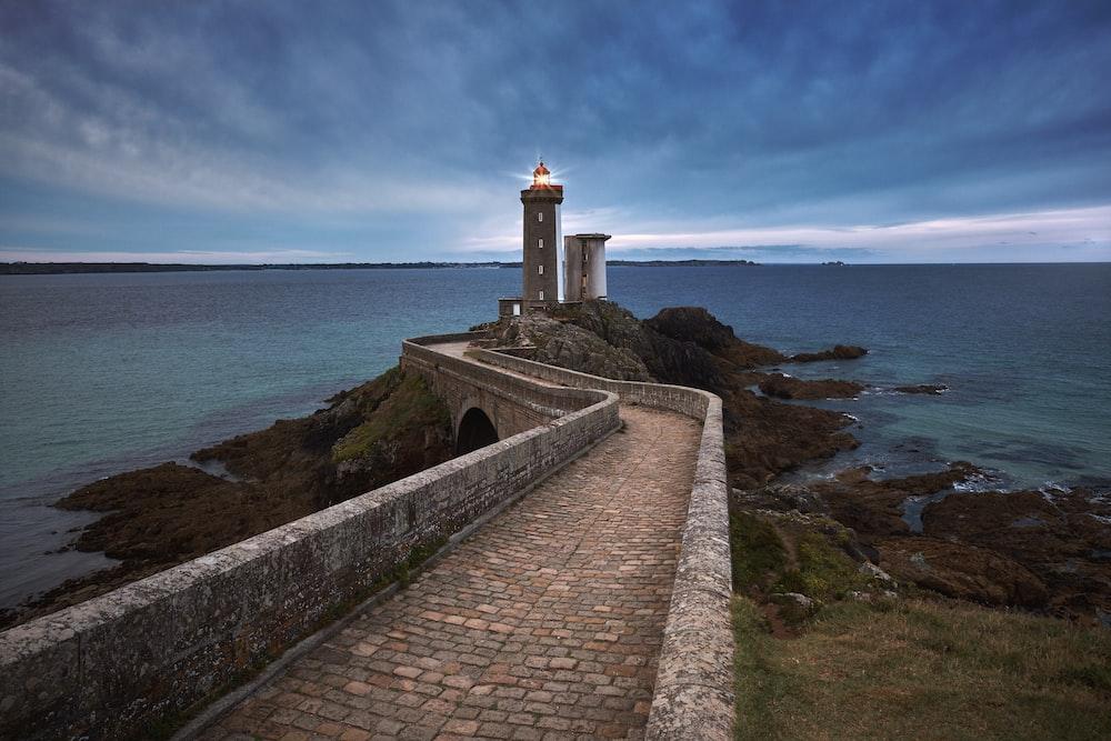 photo of lighthouse under blue sky