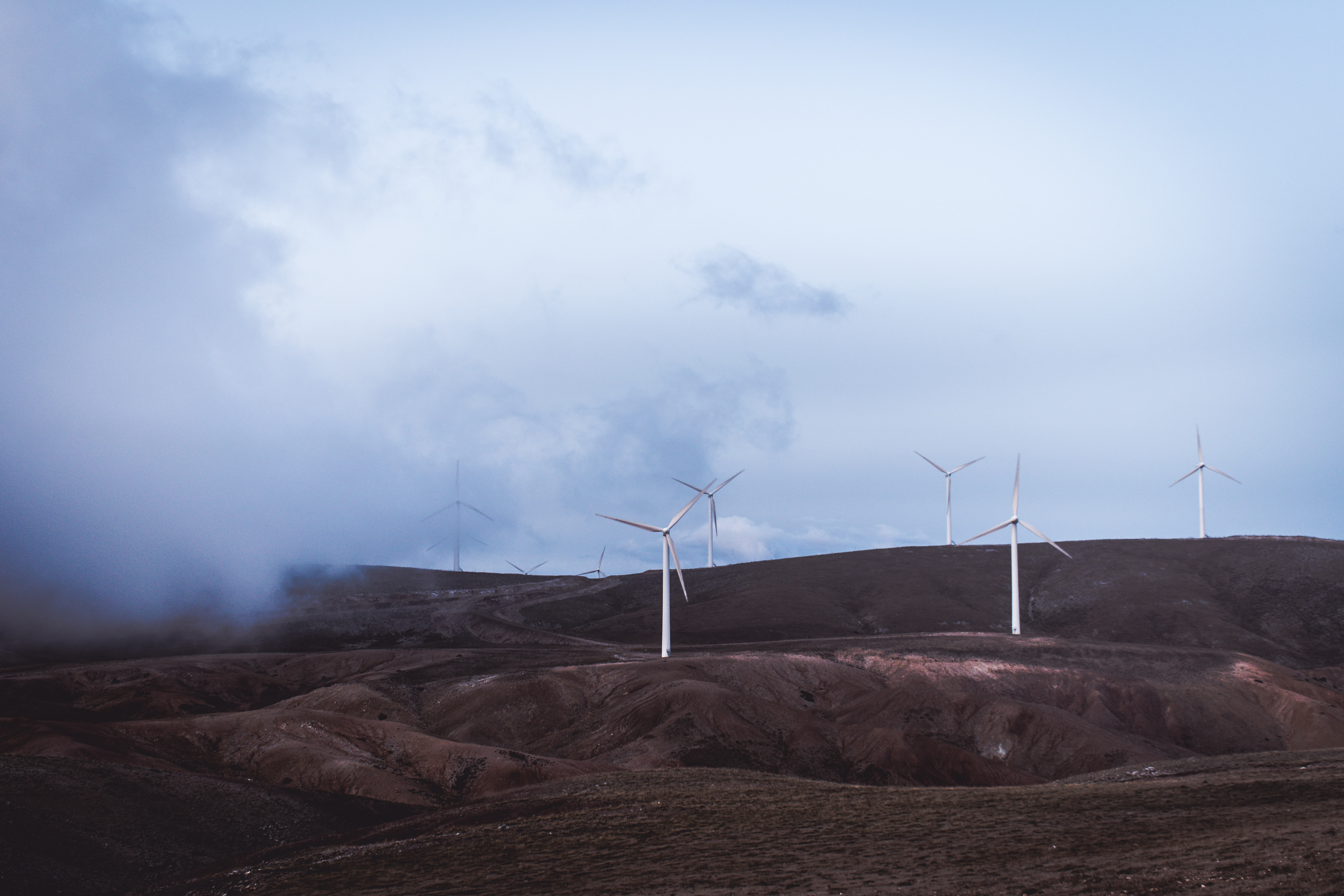 photo of windmills during cloudy daytime