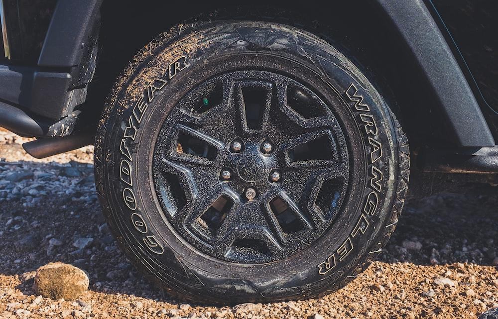 black vehicle wheel with Wrangler tire