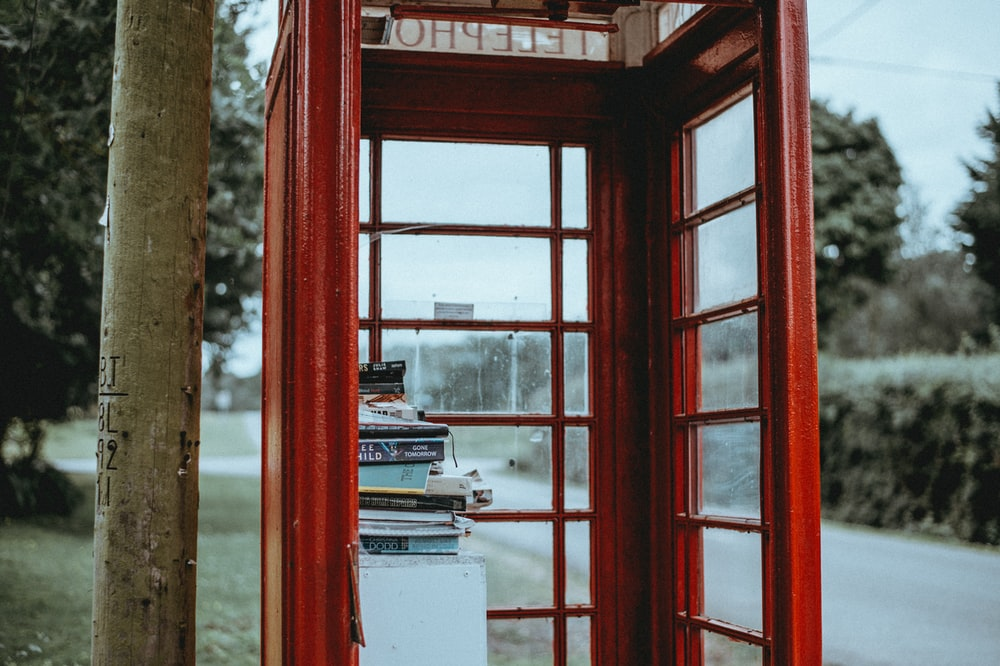 close up photography of red telephone booth