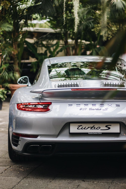 selective focus photography of silver Porsche coupe