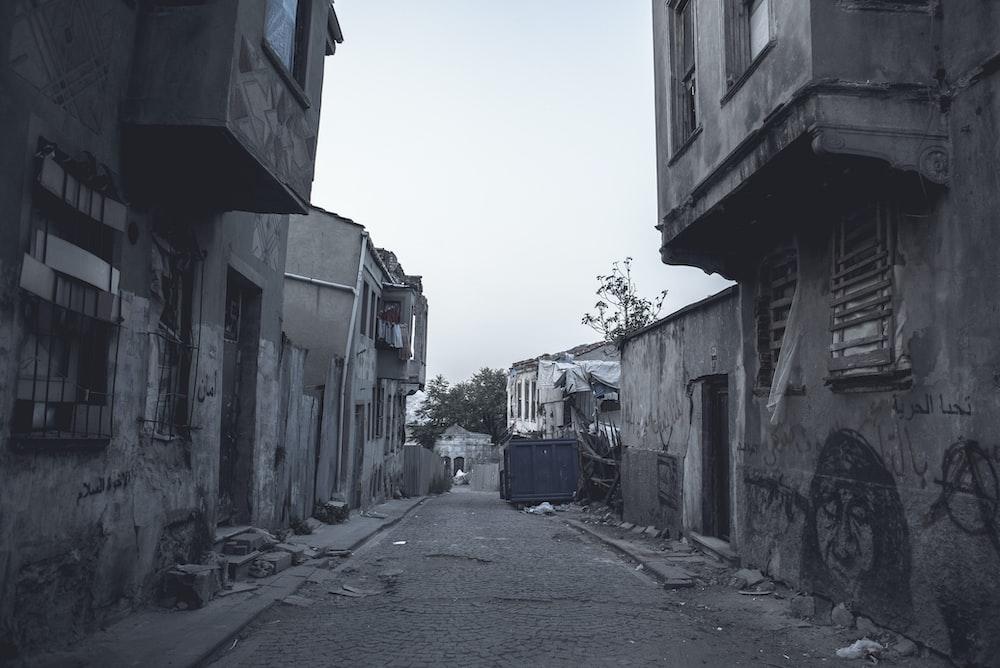 gray concrete pathway between buildings