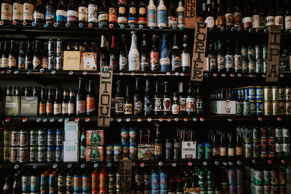 labeled glass bottles on shelf