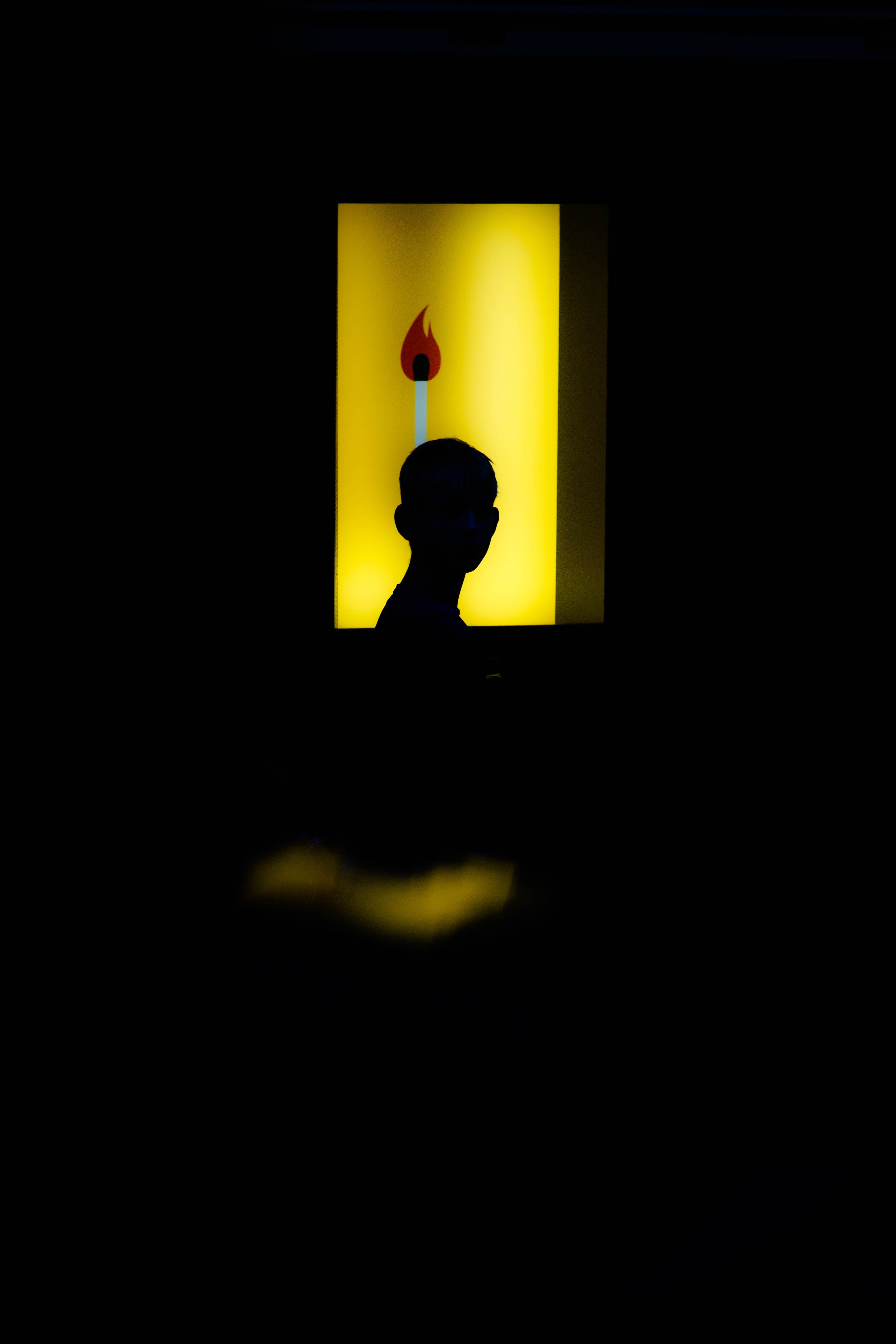 silhouette of human toward with lighted room photography