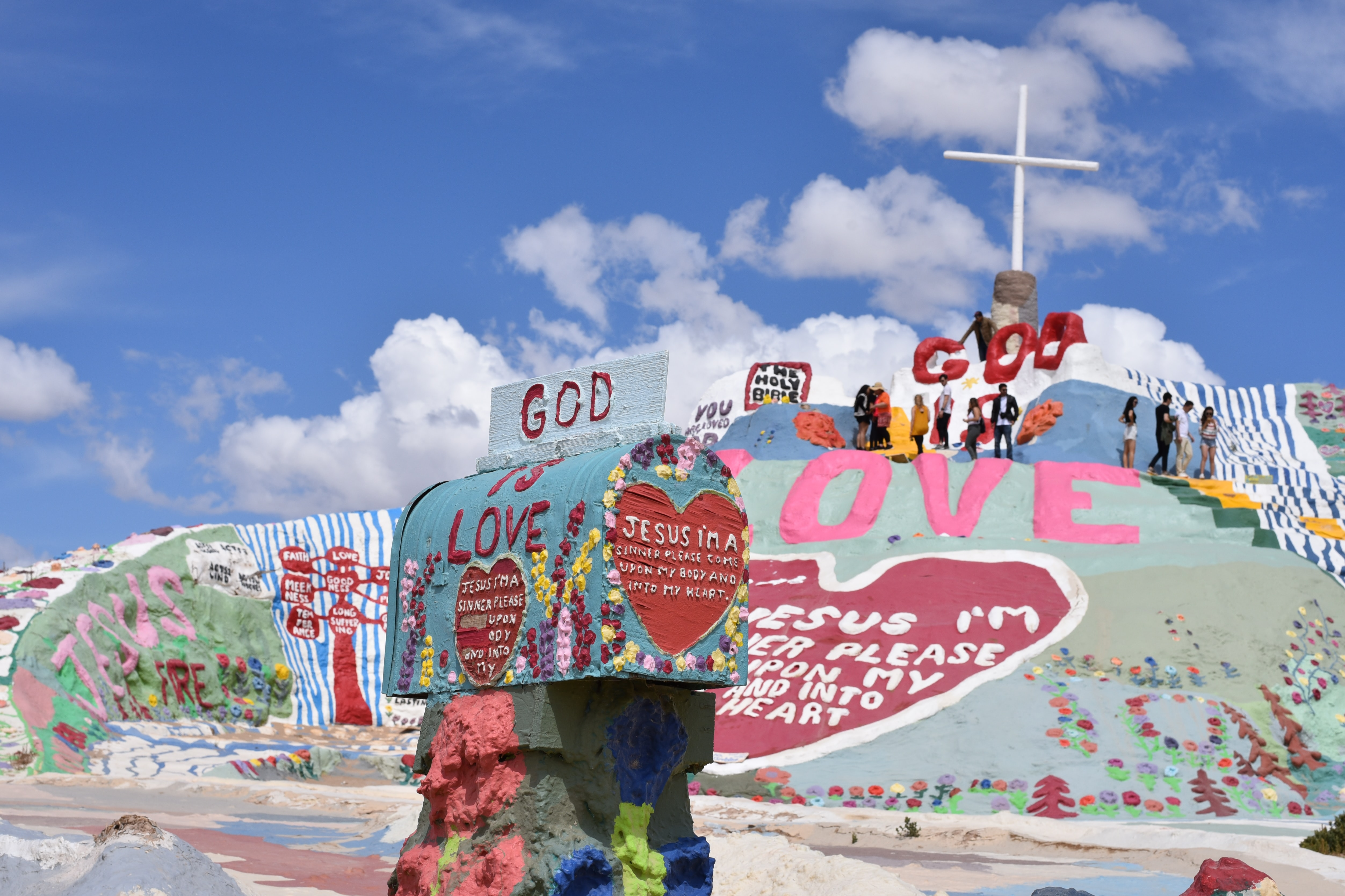 multicolored God is Love paintings under clear blue sky