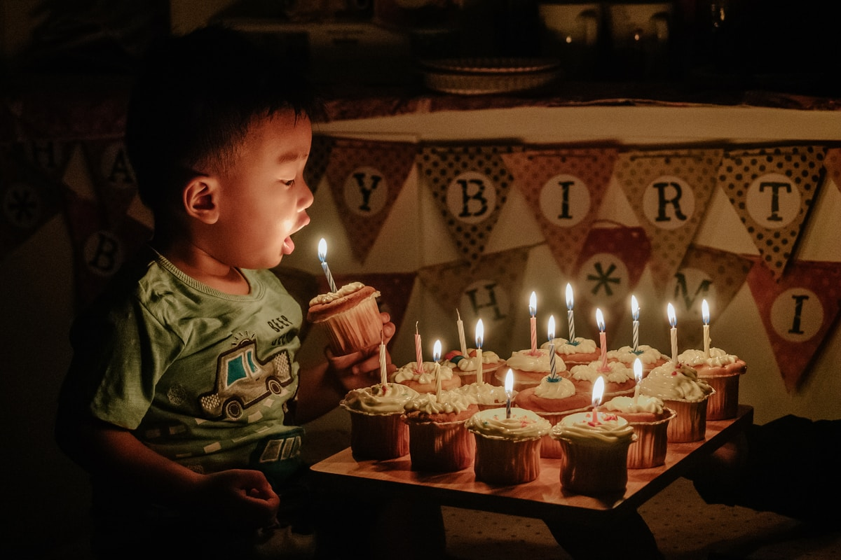 I know no heart shaped cake, and this is not my husband, obviously! This is a stock photo of some kid blowing out a candle on a cupcake.