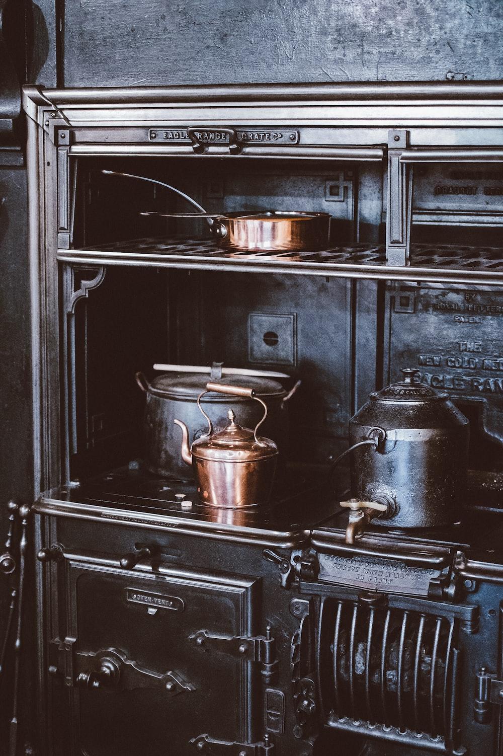 gray stainless steel teapot on range oven