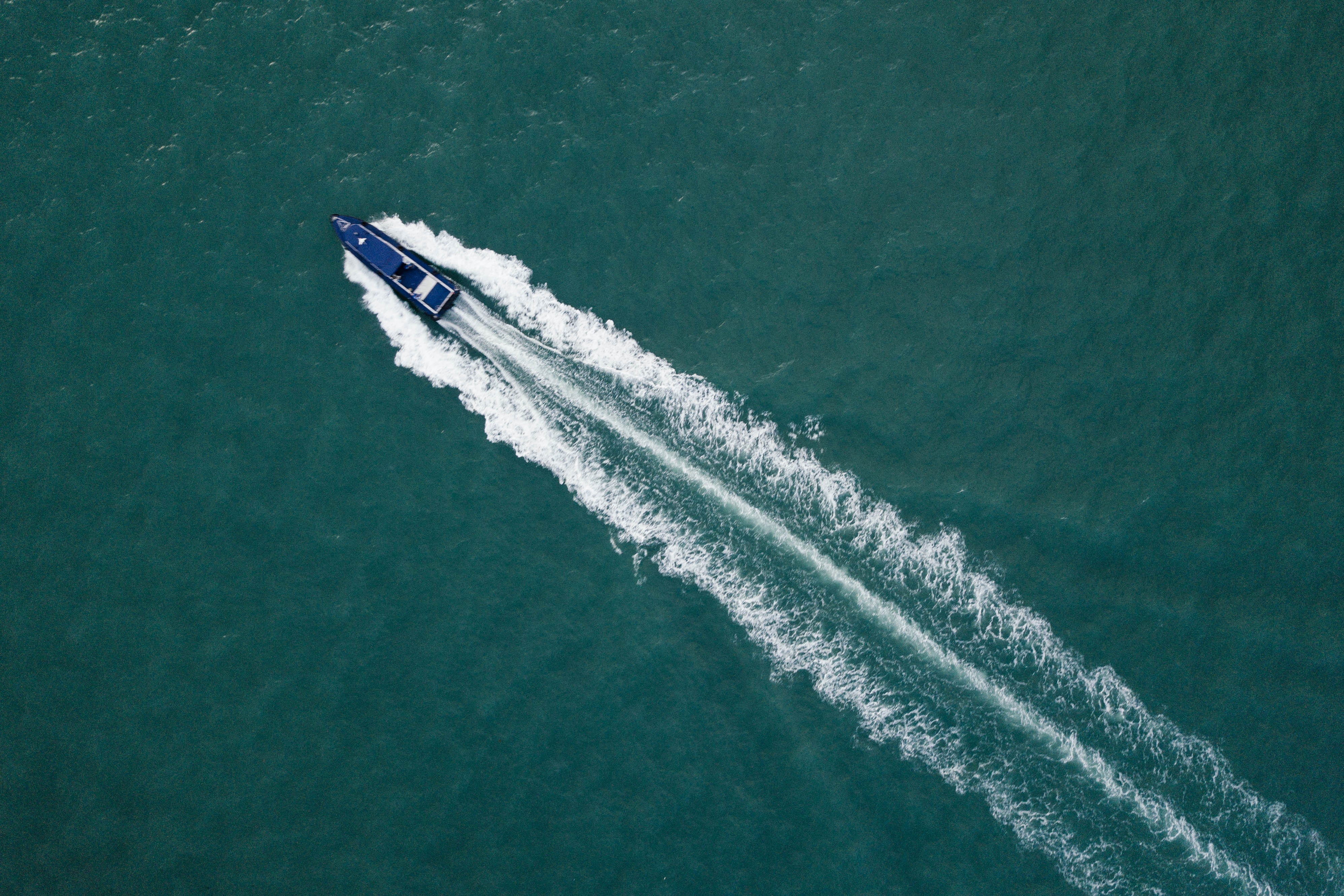 top view photography of blue boat at daytime