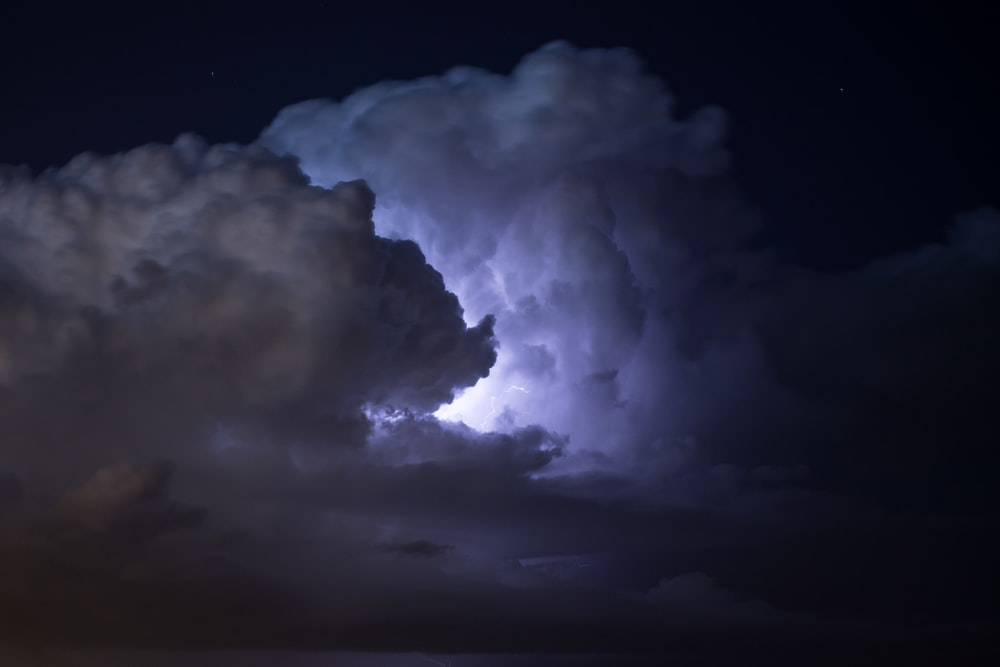 photo of moon covered by white clouds