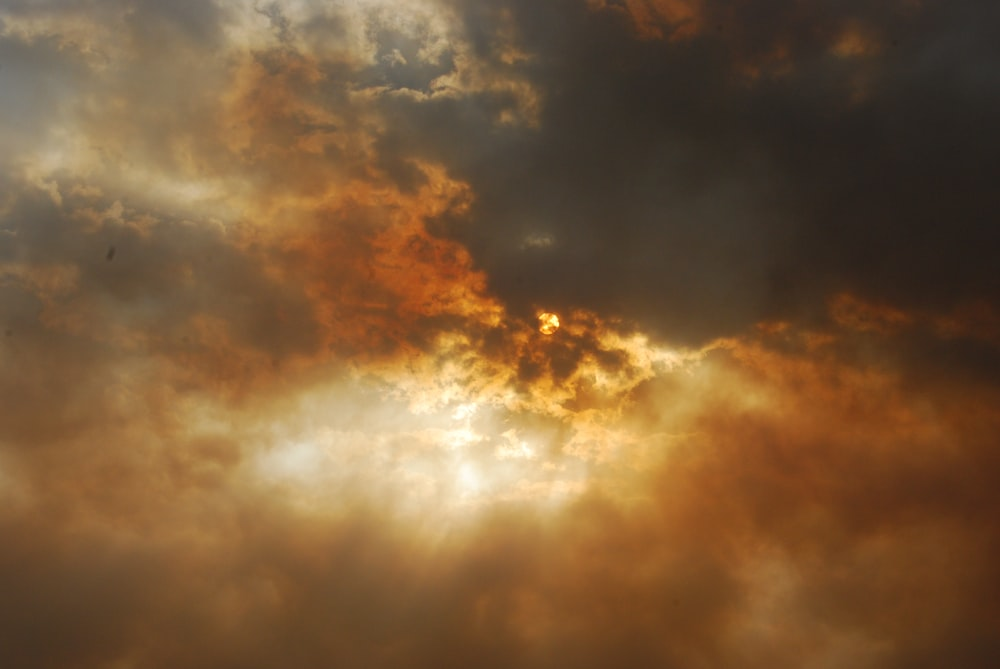 photo of sun covered by white clouds