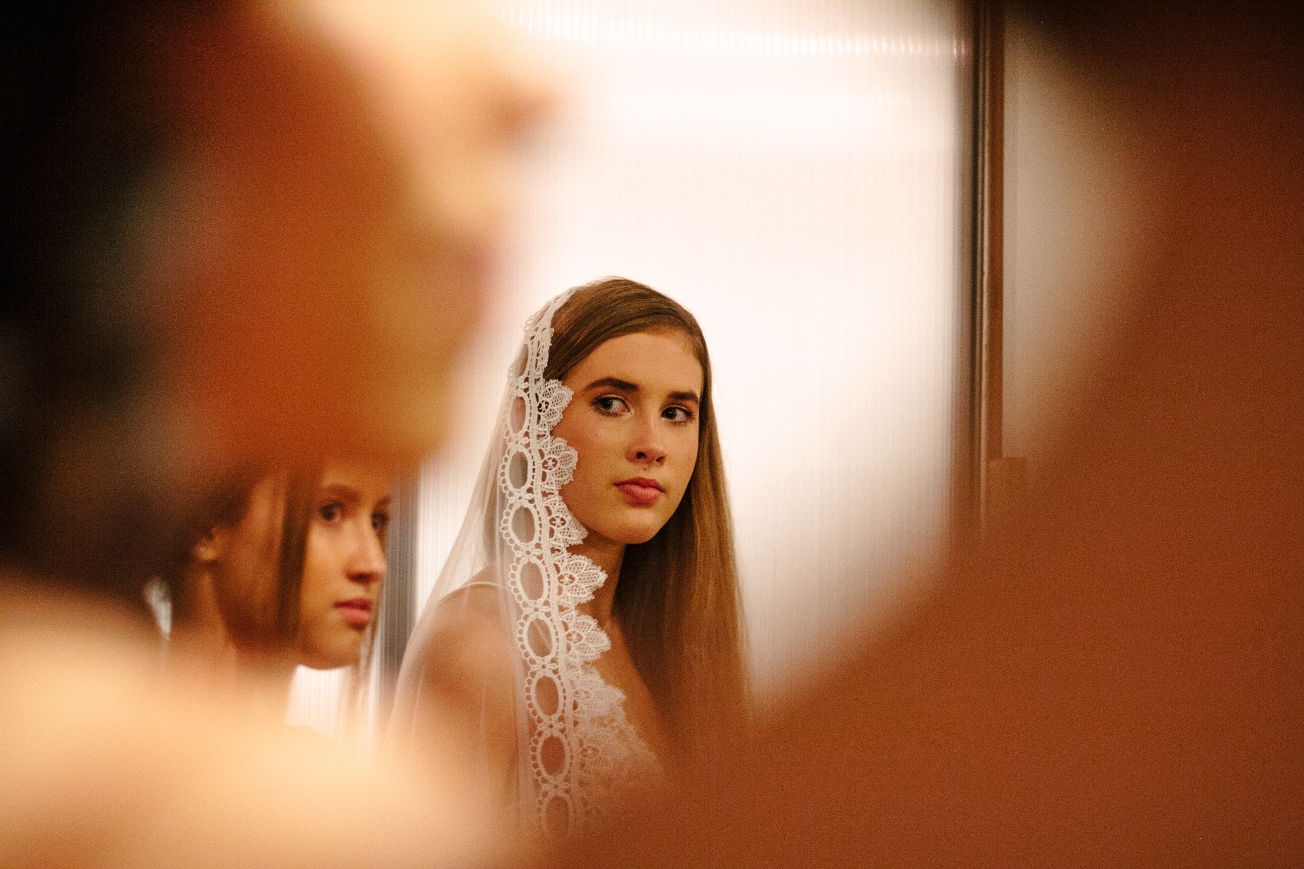 selective focus photo of woman wearing white veil